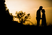 silhouette of a couple at sunset