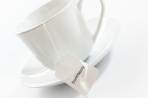 tea cup with the word uncertainty on the tea bag
