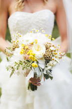 torso bride holding a bouquet of flowers