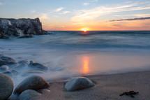 tide washing onto a shore at dawn