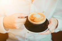 man holding a latte