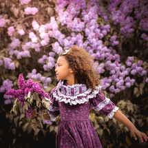girl surrounded by purple flowers
