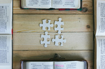 open Bibles and puzzle pieces