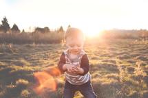 Sunshine on a little girl in a field.