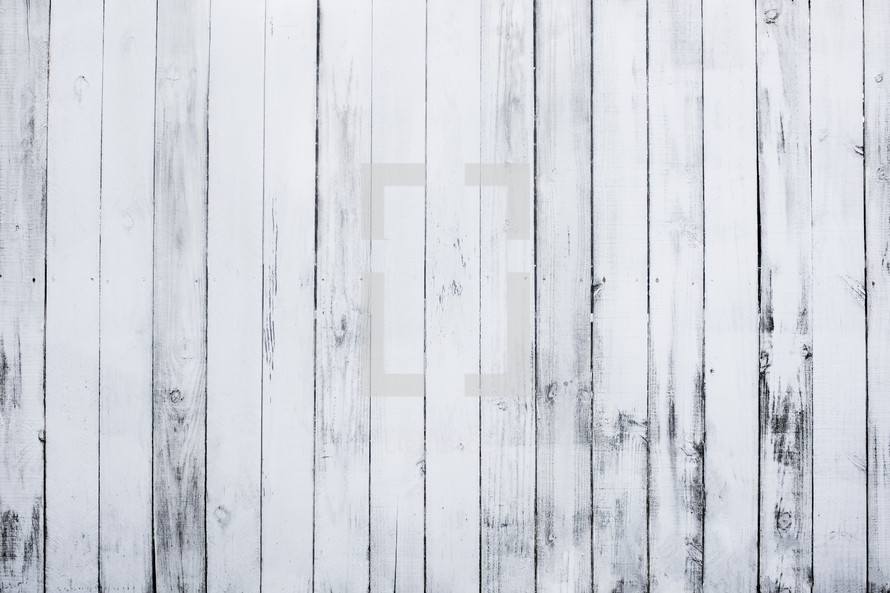 white, weathered wooden fence.