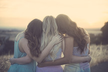friends hugging outdoors