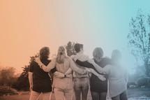 women's group with arms around each other