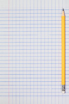 sharpened pencil on graph paper