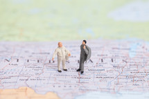 figurines standing on a map of the United States