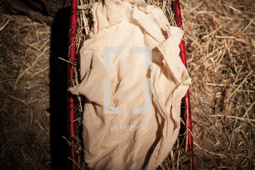 A mange covered in red wrapping paper symbolizing God's gift to us in Jesus