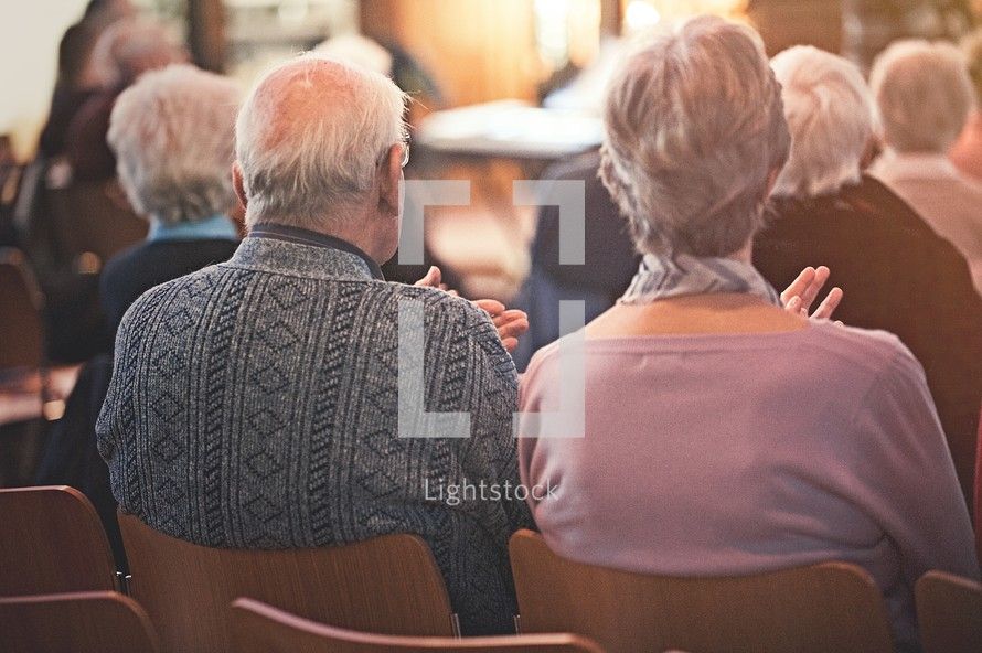 congregation sitting in church pews at a worship service