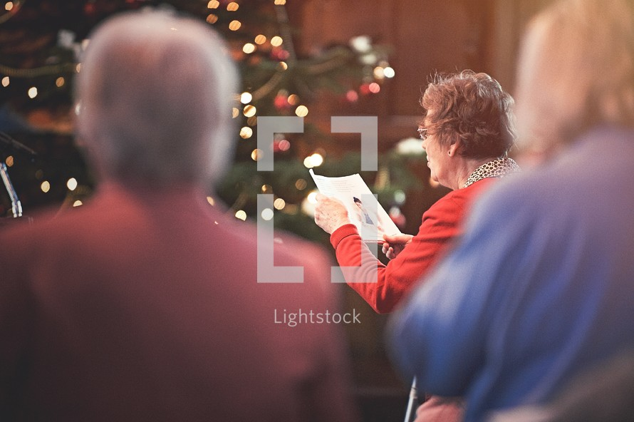 congregation singing hymns at a Christmas worship service