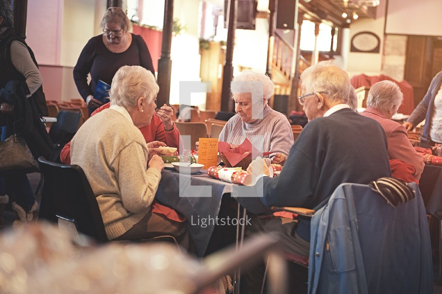 elderly couple eating at a church banquet