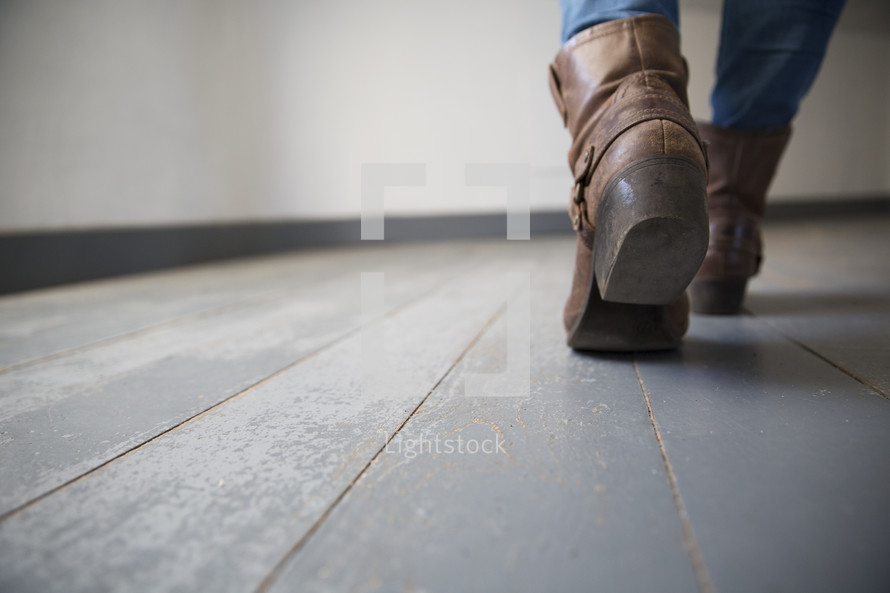 boots walking on floor boards