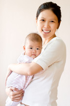 An Asian mother and her infant