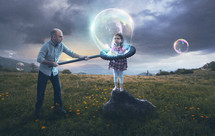 A father puts his reluctant child inside a bubble