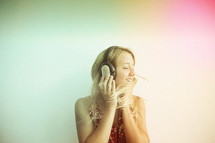 a teen girl dancing to music from headphones