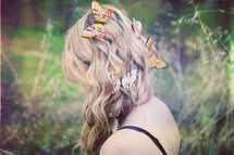 woman with butterflies in her hair