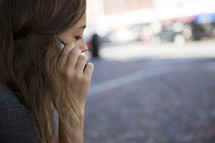 a young woman talking on her cellphone