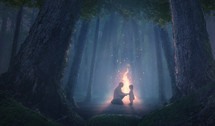 A father comforts his scared daughter in the forest