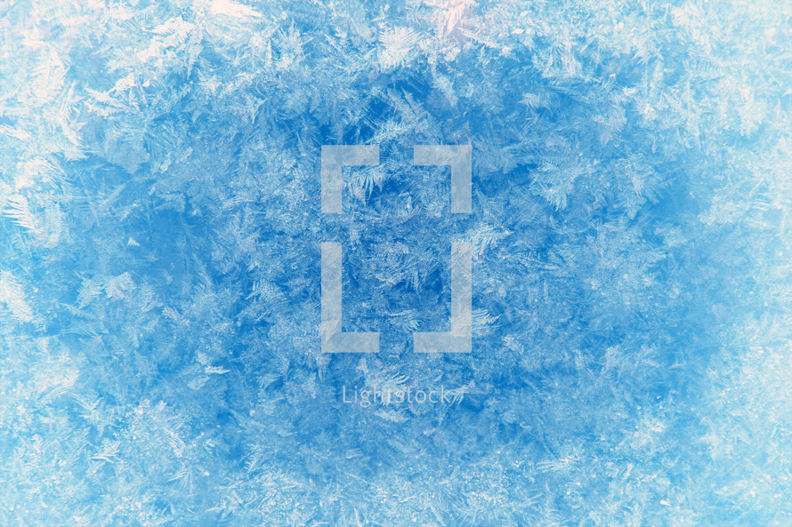 ice crystals background on blue