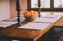 basket of oranges as a centerpiece on a dining room table