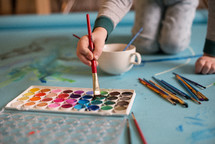 child painting with watercolor