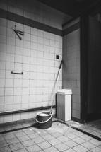 mop bucket on a tile floor