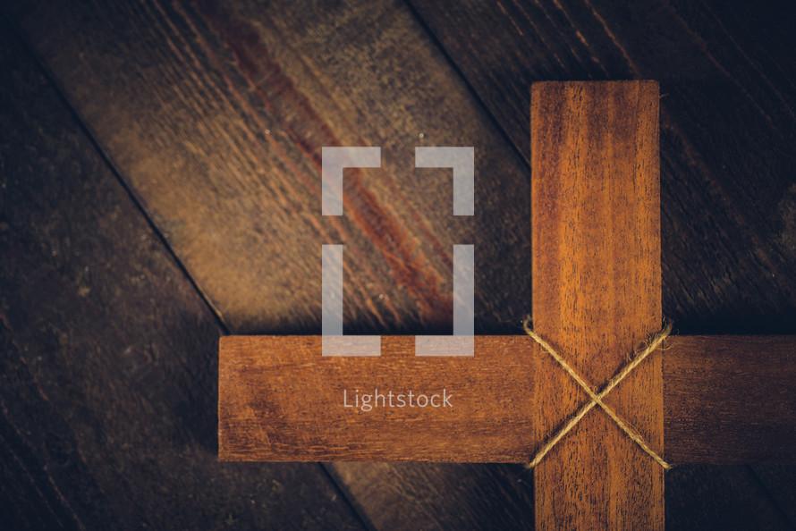 wooden cross on a wood floor