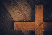 wooden cross on a wood floor