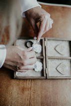 arranging wedding bands in a box