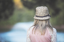 teen girl in a hat with back to the camera
