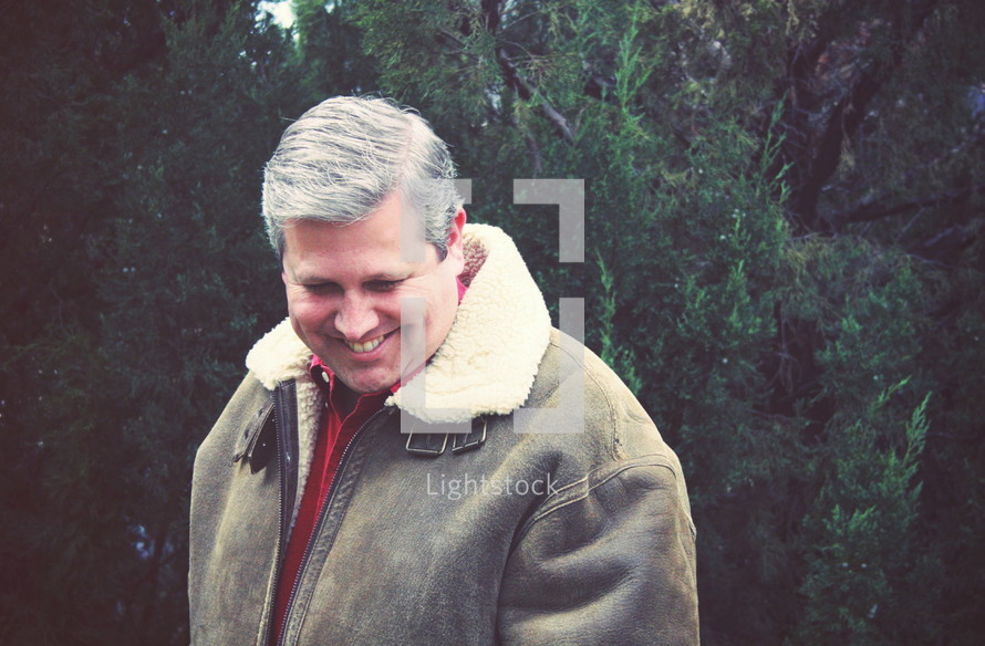 man in a winter coat smiling