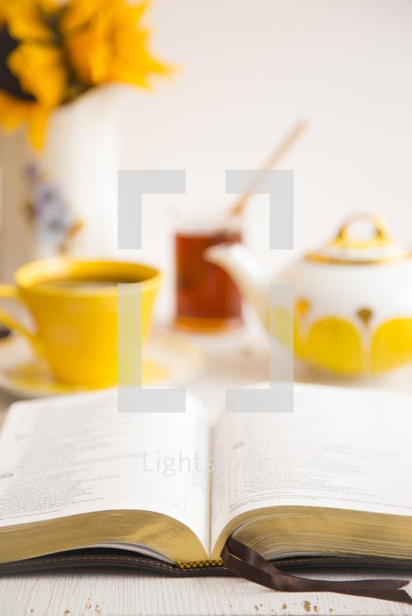open Bible and tea