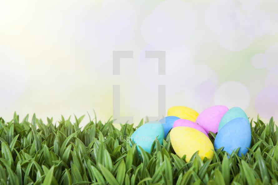 plastic easter eggs in grass