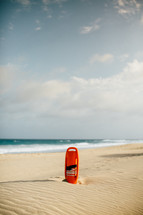 lifeguard float in the sand