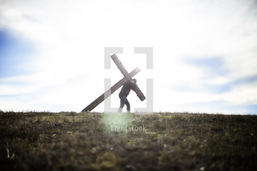 Modern day man carrying his cross