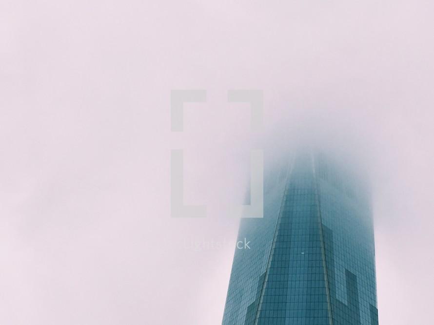 skyscraper in fog