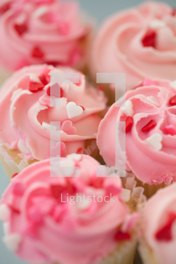 heart shaped sprinkles on pink cupcakes for Valentine's day