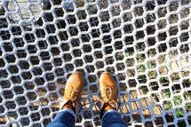 feet standing on a net