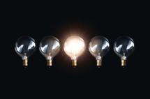 glowing lightbulb in darkness