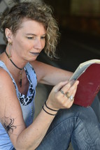 a woman battling addiction reading a Bible
