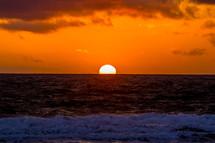 sun setting over the ocean
