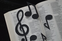 Bible open to Psalm 23 with notes and clef.