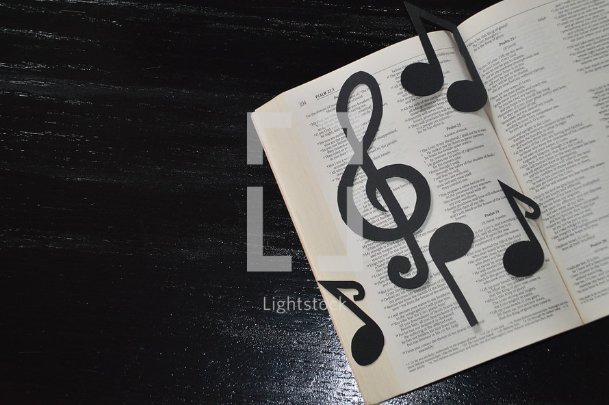 Bible open to psalm 23 with notes and clef     — Photo