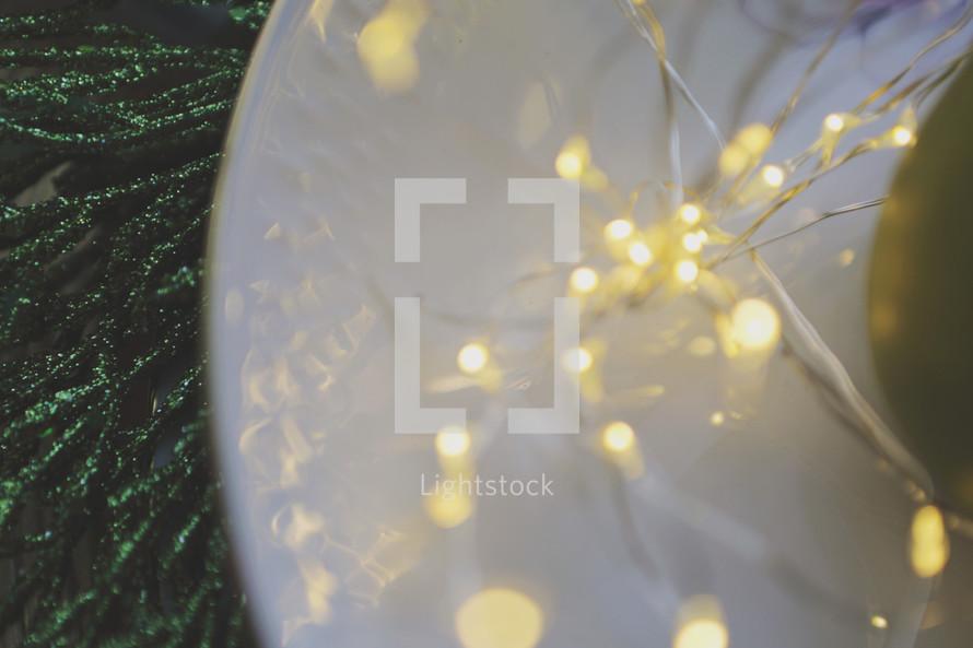 blurred fairy lights on table setting