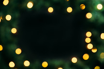 bokeh lights and pine garland frame