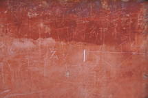 Ancient red brick an plaster wall with Chinese writing