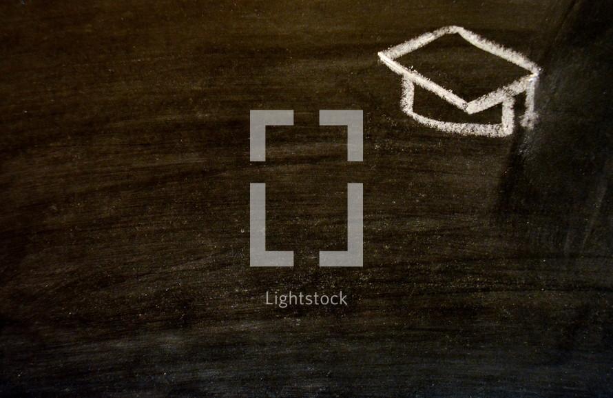 graduation cap in chalk