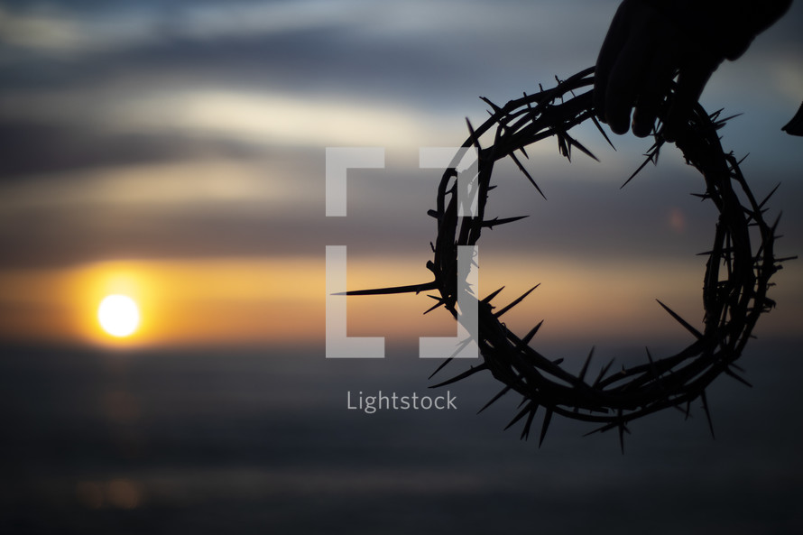 setting sun and crown of thorns